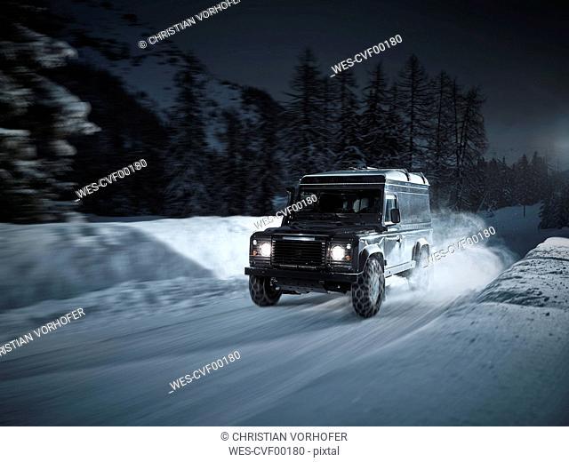 Austria, Tyrol, Stubai Valley, off-road vehicle in winter at night