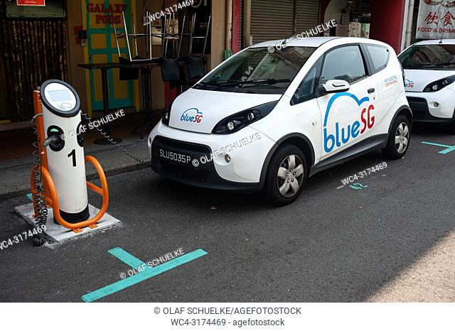 04. 04. 2018, Singapore, Republic of Singapore, Asia - A Blue SG electric vehicle (EV) is recharged at a charging station in Chinatown