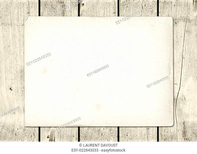 Blank vintage paper sheet on a white wood board