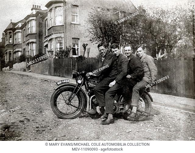 Four men on a 1923 Rudge 500cc ohv motorcycle in unmade road in the 1920s