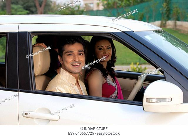 Portrait of couple in car