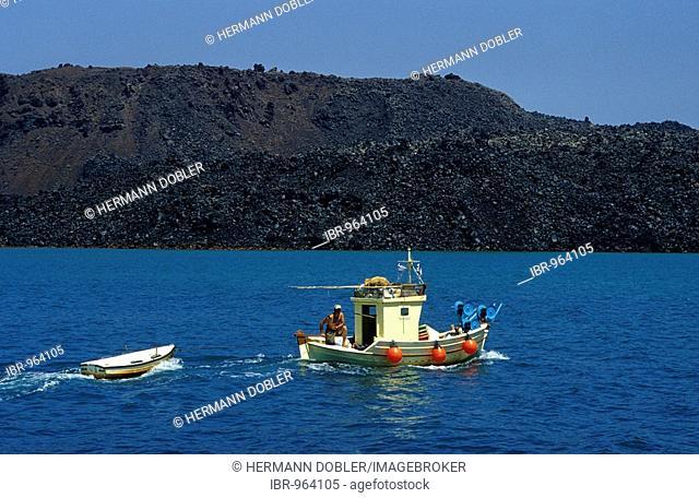 Fishing boat near Nea Kameni, Santorini islands, Greece, Europe