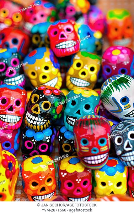 Colorful painted skulls are sold on the market during the Day of the Dead celebrations in Mexico City, Mexico, 28 October 2016