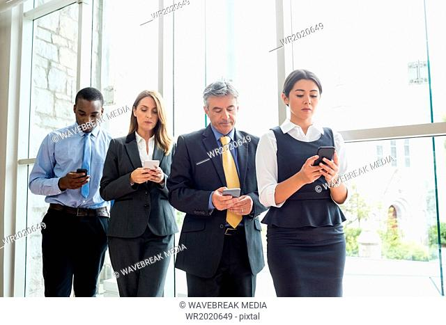 Business people posing with their smartphone