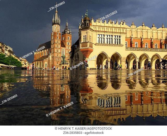 Main Market Square at the wet evening Krakow, Poland