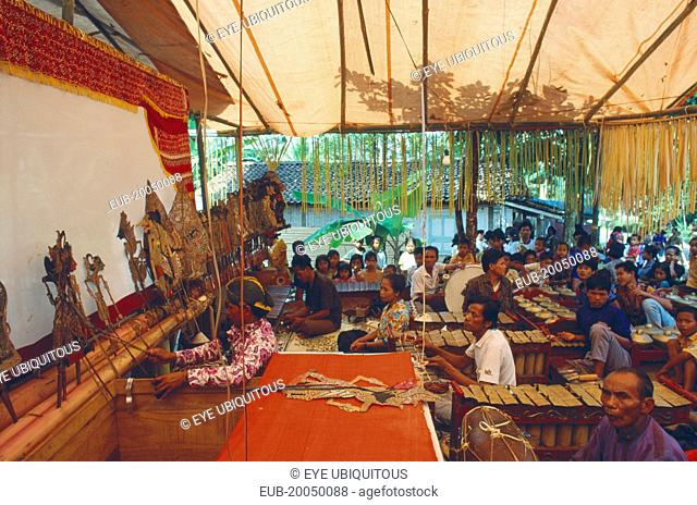 Shadow puppet show with Wayang and Gamelan orchestra behind the scenes