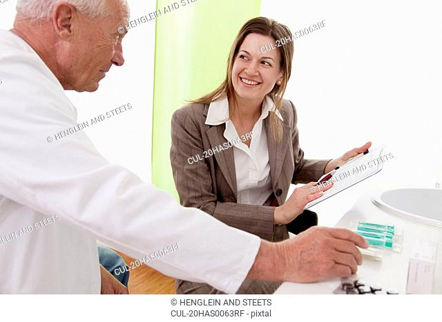 Doctor and businesswoman in surgery
