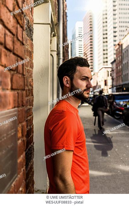 USA, New York City, man on pavement in Manhattan looking around