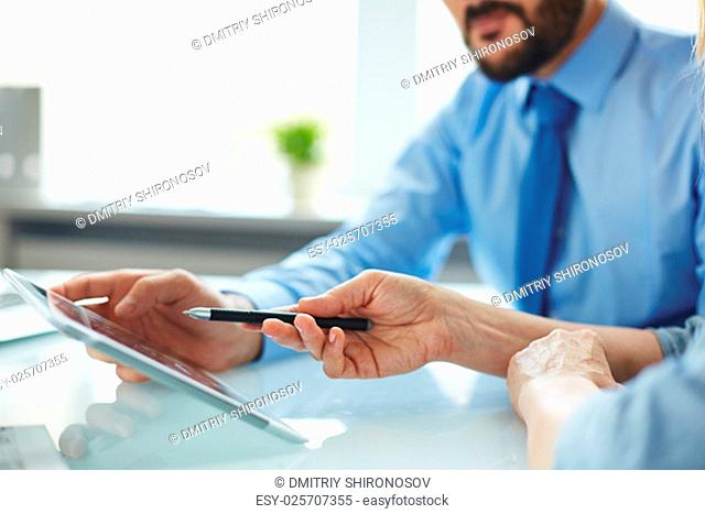 Businesspeople using touchpad in office