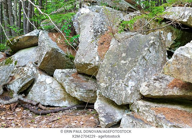 Remnants of granite splitting (plug and feathers) at the abandoned Bemis Granite Quarry along the Sawyer River in Harts Location, New Hampshire USA