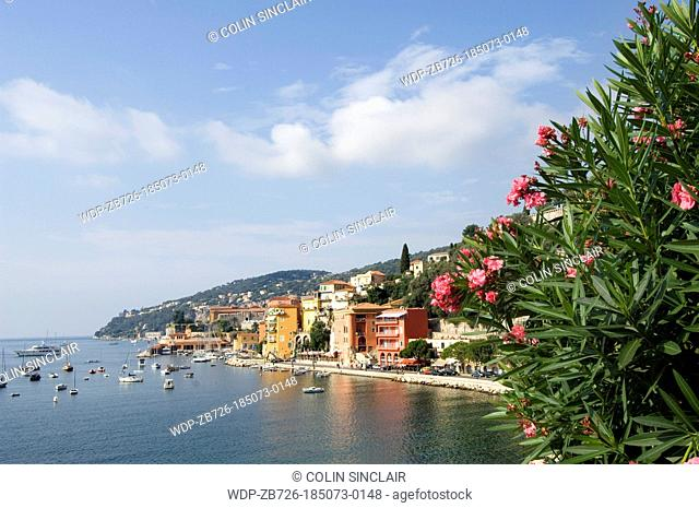 Villefranche sur Mer, bay with boats, flowers in foreground