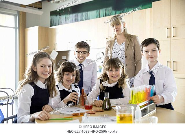 Elementary students and teacher in science classroom