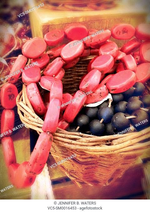 Closeup of colorful wooden beads in a basket