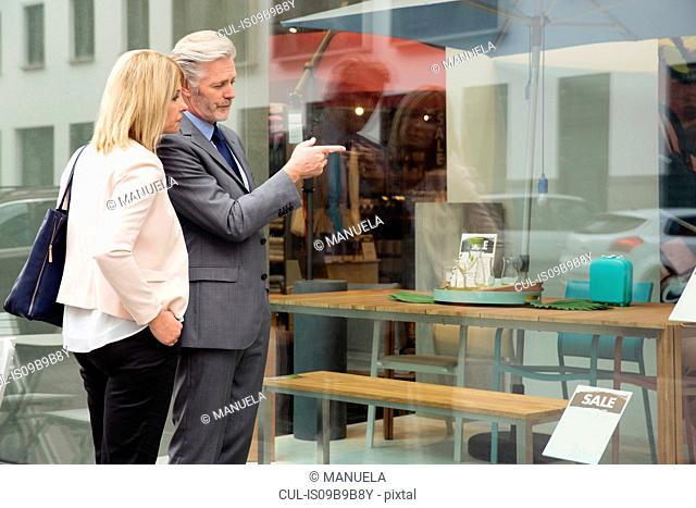 Couple window shopping in homewares shop window