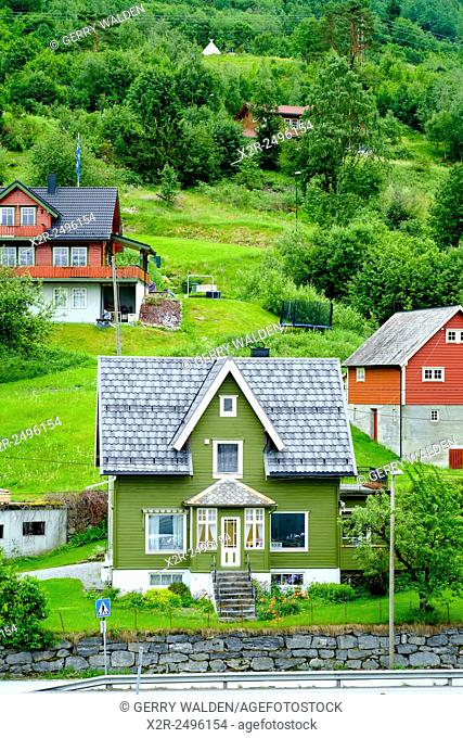 Green house typical of the architecural style around Olden fjord in Norway
