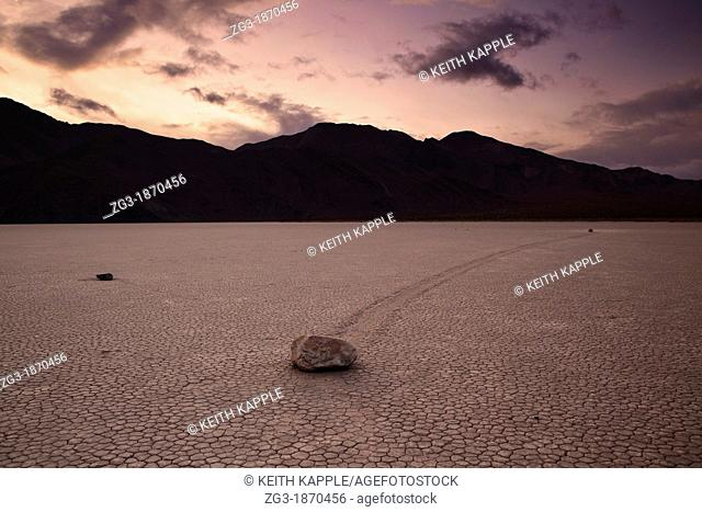 Granulated surface of sandy playa called The Racetrack where rocks move mysteriously below the Cottonwood Mountains in Death Valley National Park, California