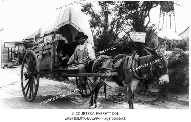 Mexican man on a donkey cart emigrating to the United States via Nuevo Laredo, directly across the Rio Grande River from Laredo, Texas. Ca. 1912