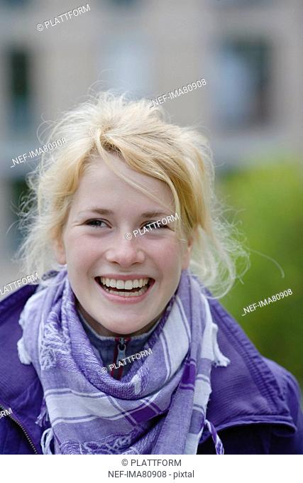 Portrait of smiling teenage girl in park