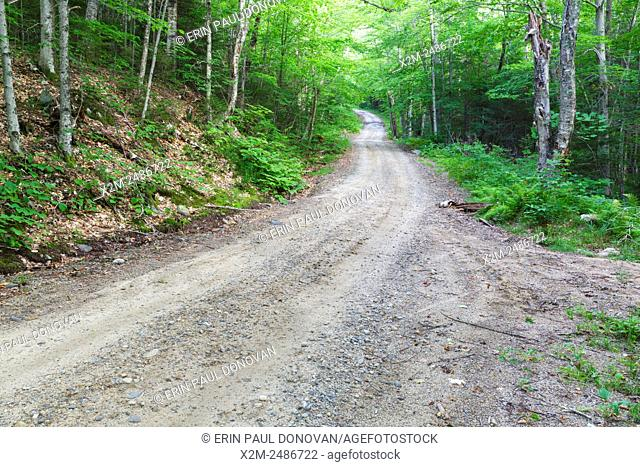 The Sandwich Notch Road, established in 1801, in Sandwich, New Hampshire. This section of road is referred to as â. œWinding Hillâ. .