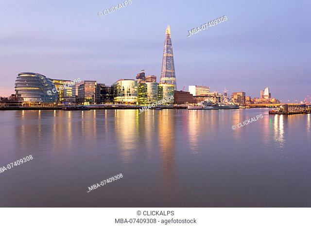 Southwark area with City Hall and Shard reflected in river Thames at dawn, London, Great Britain, UK