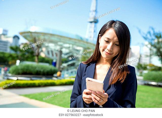 Businesswoman using mobile phone in Nagoya city