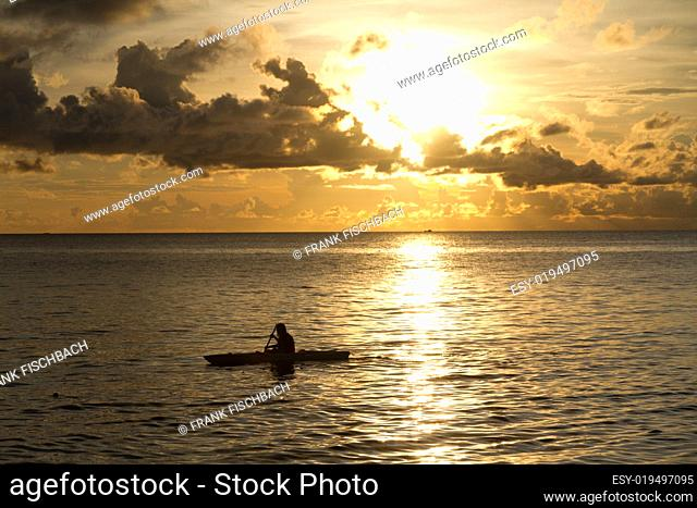 Sunset at South China Sea with canoe in Phu Quoc close to Duong Dong, Vietnam