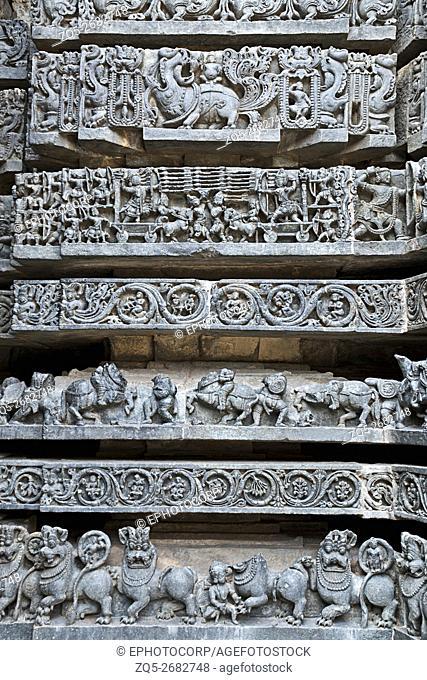 Friezes of animals, scenes from mythological episodes from Ramayana and Mahabharata, at the base of temple, Hoysaleshwara temple, Halebidu, Karnataka, india