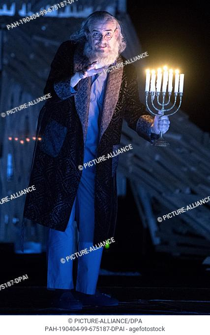 "03 April 2019, Saxony, Dresden: The actor Holger Hübner is on stage during a photo rehearsal for the play """"Eine Straße in Moskau"""" at the Staatsschauspiel..."