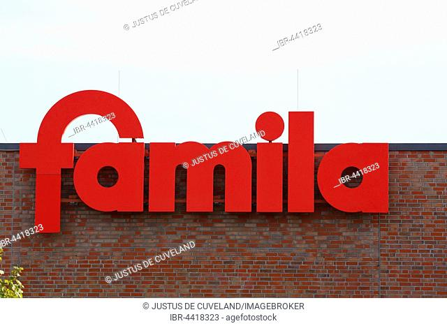 Company logo sign of supermarket and department store chain Famila, Germany
