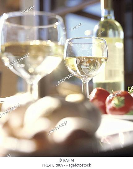 White wine in glasses, mediterranean food