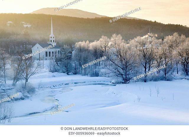 Sunrise over Stowe Community Church on a cold winter morning, Stowe, Vermont, USA