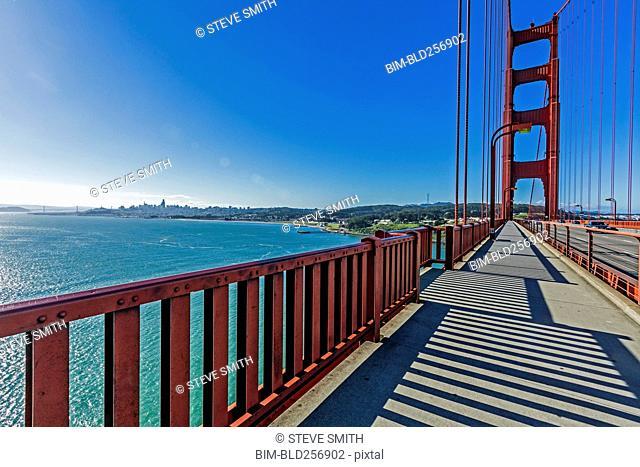 Shadows on walkway of bridge