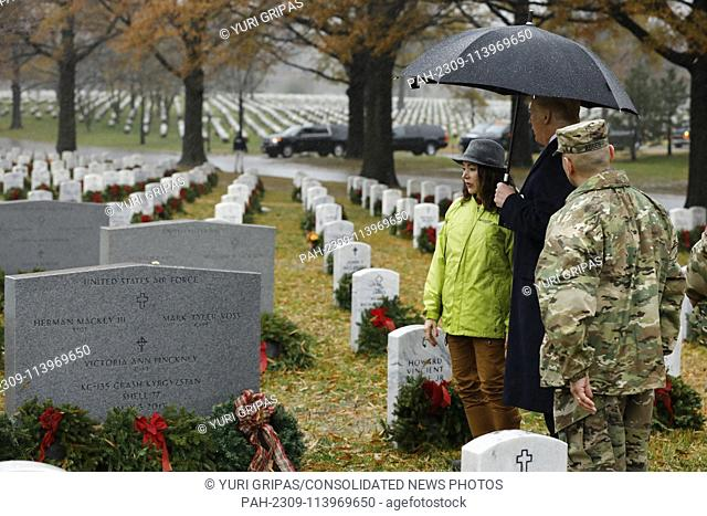 United States President Donald J. Trump visits Section 60 at Arlington National Cemetery in Arlington, Virginia on Saturday, December 15, 2018