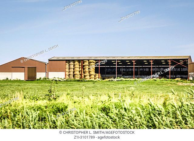 Large barn loaded with bales of hay at a farm