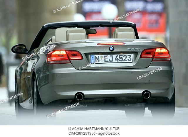 BMW 335i Convertible, model year 2007-, silver, standing, upholding, diagonal from the back, rear view, City, open top