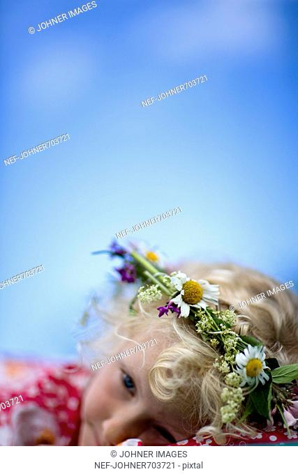 Scandinavian girl with a wreath of flowers in her hair, Sweden