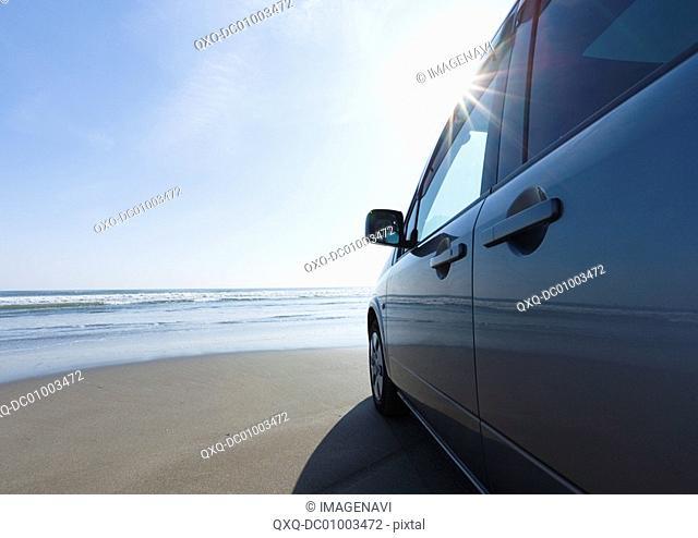 Car on a sandy beach