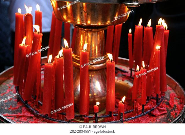 Red candles burning at the Longshan Buddhist Temple at Chinese New Year in Taipei, Taiwan