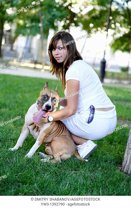a girl and her dog outdoors