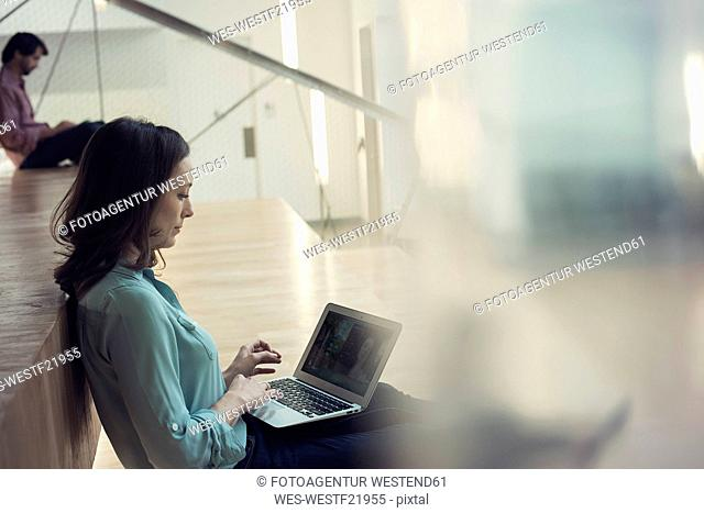 Businesswoman having a video conference on laptop