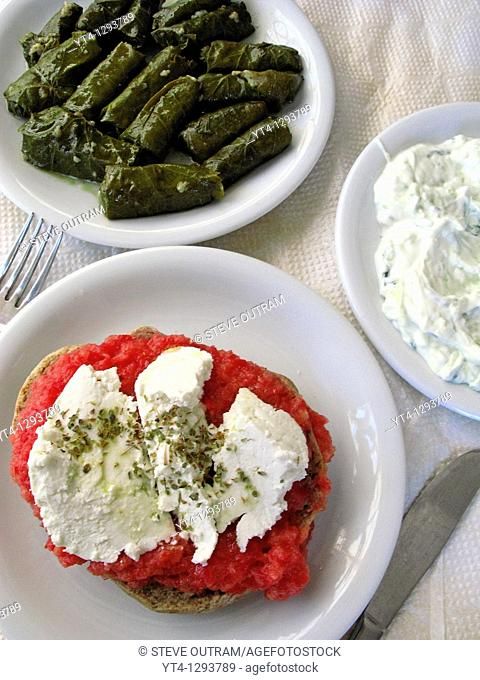 Greek Cuisine  Dakos Barley Rusk with Feta Cheese, Dolmades Vine Leaves and Tzatziki