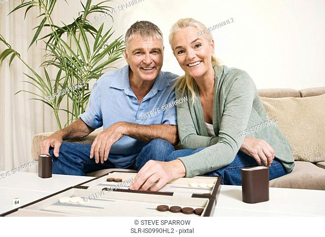 Couple playing backgammon