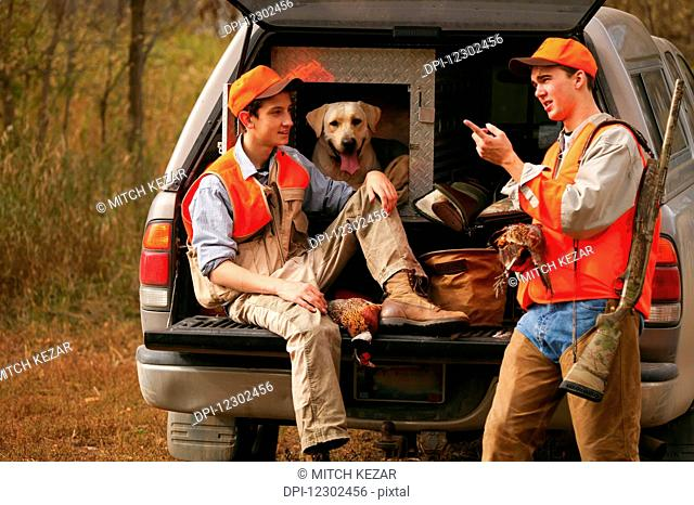Young Hunters With Dog On Tailgate