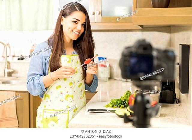 Portrait of an attractive young woman recording a cooking tutorial for her video blog