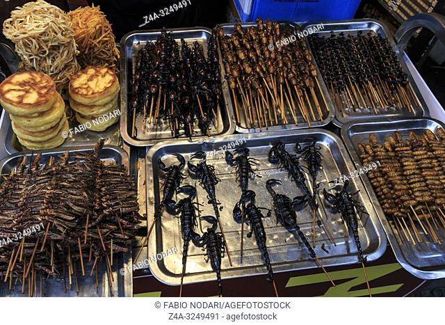 Chengdu, China - December 12, 2018: Insects and scorpions sold in a street market in Chengdu