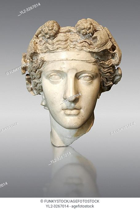 Roman sculpted head of Dionysus inspired by a Hellenistic original. Found in the Horti Lamiani near the Piazza Vittorio Emanuele, Rome. M. C