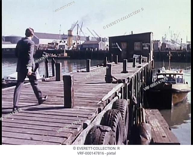 Rear view of man walking on pier