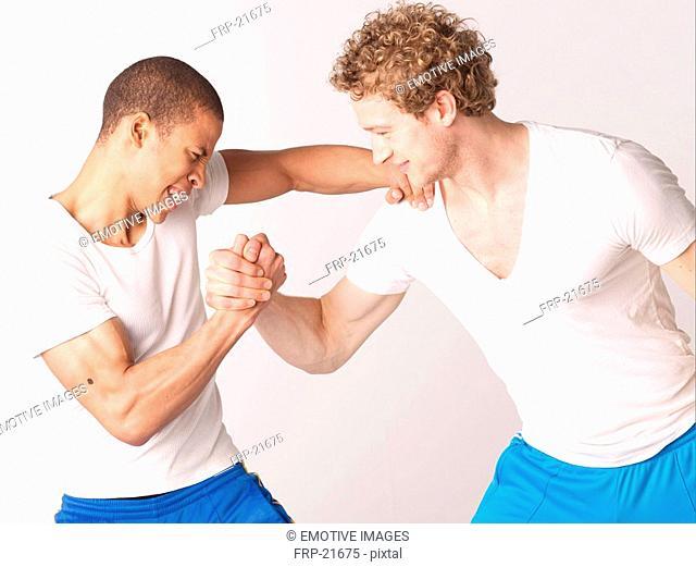 Two friends arm wrestling