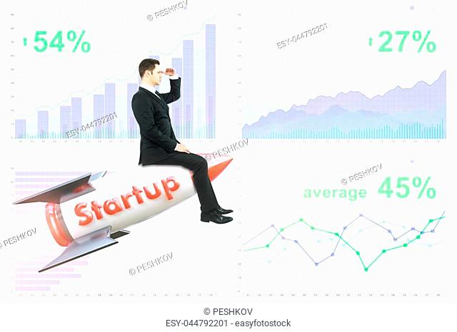 Businessman sitting on abstract launching rocket and looking into the distance on business chart background. Entrepreneurship concept