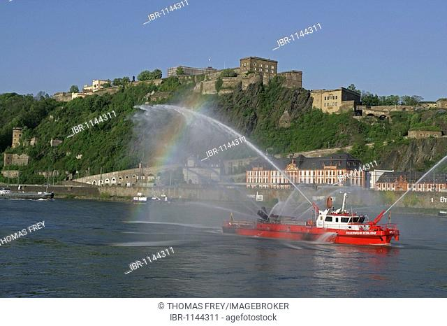 The fire-fighting boat of the fire brigade Koblenz on the Rhine river in front of the Festung Ehrenbreitstein fortress, Koblenz, Rhineland-Palatinate, Germany